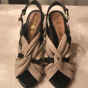 L.A.M.B buttery soft creme/black heel. Size 7-1/2